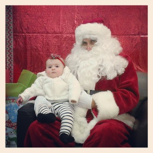 Maddy with Santa (first time!)